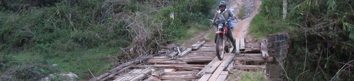 Motorbike on makeshift bridge